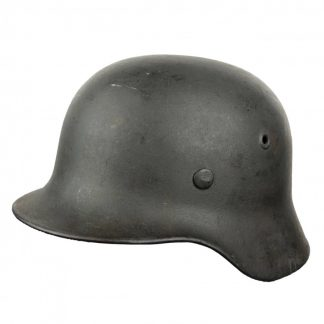 Original WWII German M40 ND helmet with battle damage