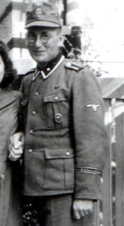 SS-Unterscharführer of Feldgendarmerie wearing the SS-Feldgendarmerie cuffband.
