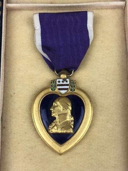 Original WWII US Purple Heart medal in box with ribbon and pin