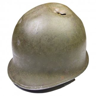 Original WWII US M1 early fixed bale helmet with battle damage